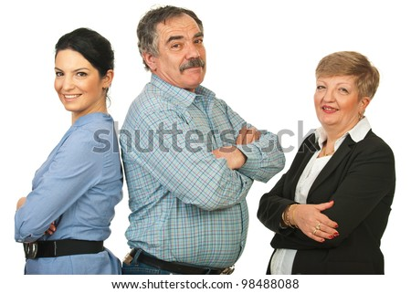 Happy group of three business people standing with arms folded in a line isolated on white background - stock photo