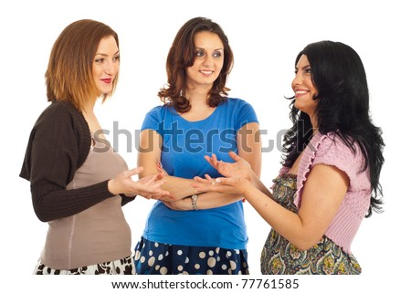 Happy group of three women having conversation and smiling isolated on white background - stock photo