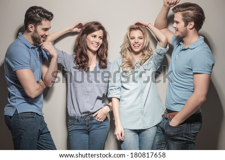 happy group of young casual fashion people laughing together  - stock photo