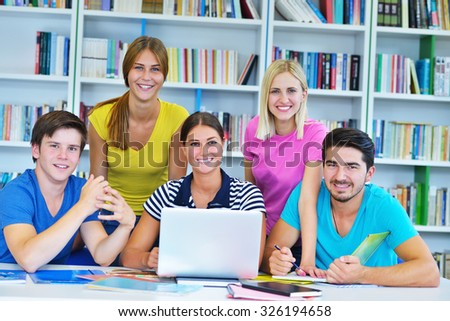 Happy Group Of Young Students Studying Together In Library