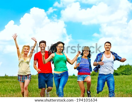 Happy group people summer outdoor. - stock photo