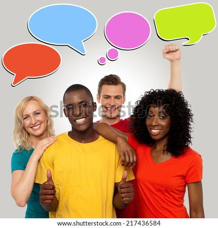 Happy group people with speech bubbles - stock photo