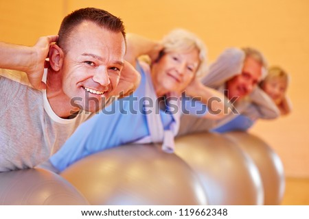 Happy group with seniors in a back course in fitness center - stock photo