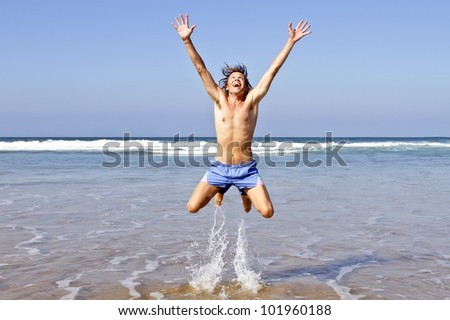 Happy guy jumping out of the water - stock photo