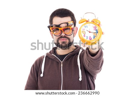 Happy guy using multiple glasses holding on her hand a orange clock - stock photo