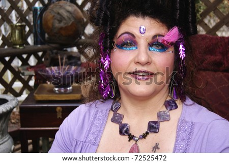 Happy gypsy with extreme makeup and hair - stock photo