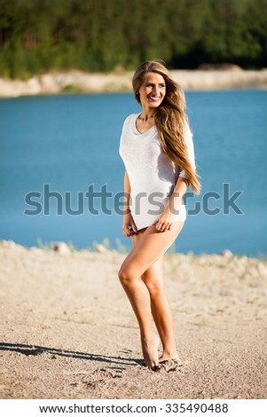 Happy hair woman on beach in a white dress. - stock photo