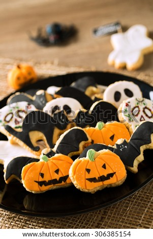Happy halloween cookies on a black plate background - stock photo