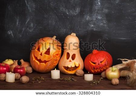 Happy Halloween; Jack-o-lantern on a dark background; pumpkin; candles; Still Halloween - stock photo