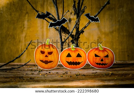Happy Halloween pumpkin on wood for halloween background. - stock photo