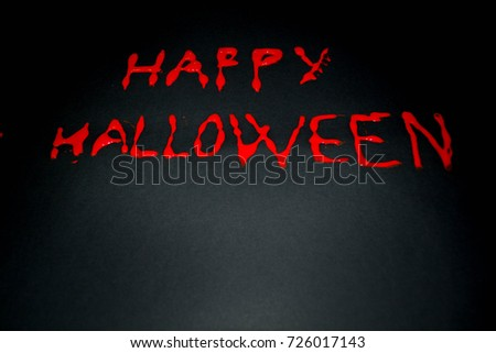 Happy halloween red words on black background. Happy Halloween text with paint or spray. Halloween inscription. Banner.