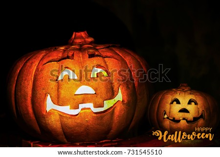 happy halloween scary night backgrounds with pumpkin pottery on black