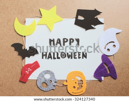 Happy halloween written on paper with halloween ornament for frame  - stock photo