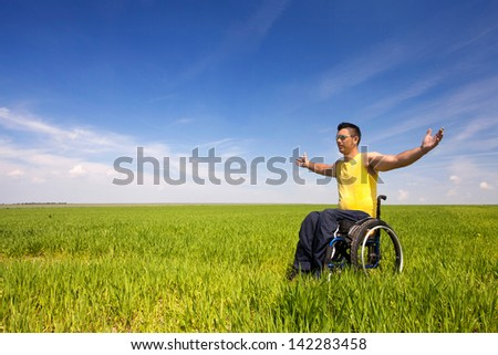 Smiling carer pushing an old man in a wheelchair stock photo image - Disabled Person Stock Photos Images Amp Pictures