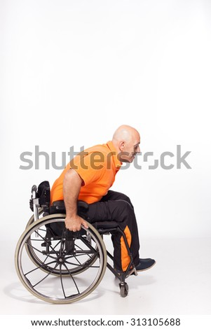 Happy handicapped person on a wheelchair ready to go isolated on white - stock photo