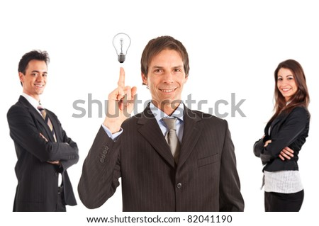 Happy handsome businessman having a good idea. Two smiling colleagues in the background. - stock photo