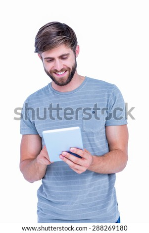 Happy handsome man using tablet computer on white background - stock photo