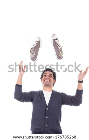 happy handsome man with sneakers smiling about sales discount - stock photo