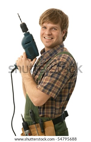 Happy handyman posing with power drill, smiling. Isolated on white.