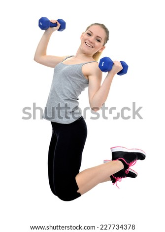 Happy healthy active girl jumps with dumbbells isolated on white background