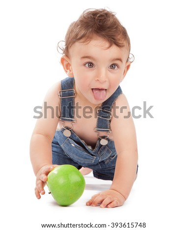Happy healthy baby boy crawls to reach the apple, having fun in the studio, isolated on white background, joyful carefree childhood