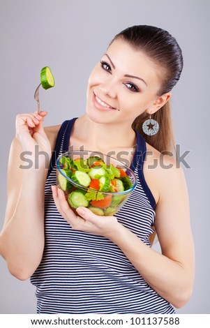 happy healthy cheerful woman with salad and fork - stock photo