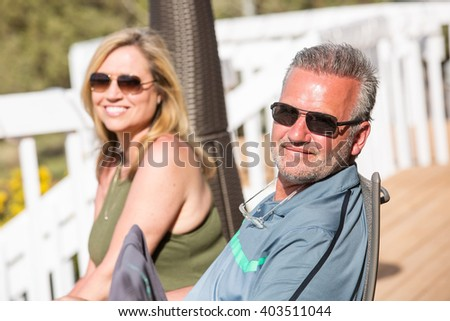 Happy, healthy couple outside on sunny day - stock photo