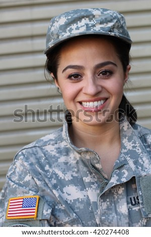 Happy healthy ethnic female army soldier - stock photo