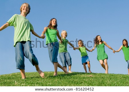 happy healthy lifestyle kids walking on hill - stock photo