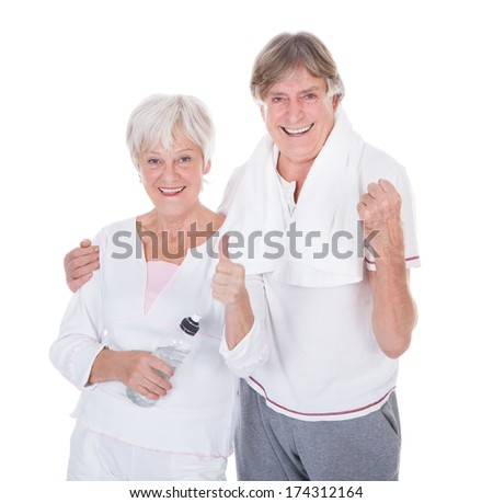 Happy Healthy Senior Couple With Towel And Water Bottle On White Background