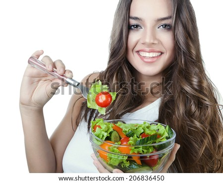 happy healthy woman with salad on fork - stock photo