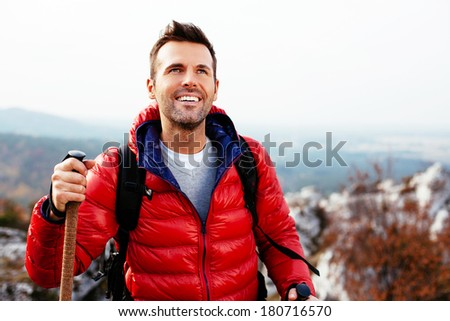 Happy hiker looking into the distance - stock photo