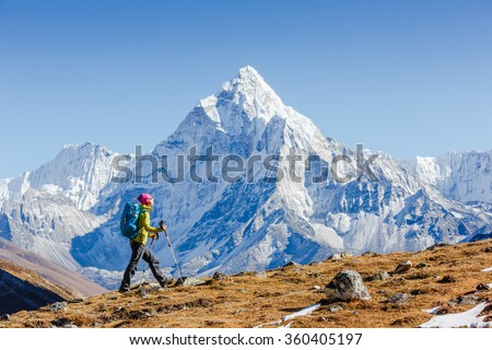 Happy hiker walking in the mountains, freedom and happiness, achievement in mountains. Himalayas, Everest Base Camp trek, Nepal