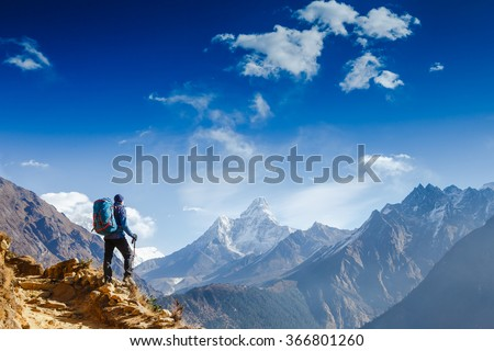 Happy hiker winning reaching life goal, success, freedom and happiness, achievement in mountains. Himalayas. Nepal - stock photo
