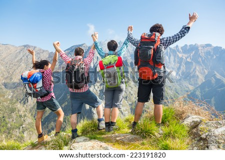 Happy Hikers at Top of Mountain - stock photo