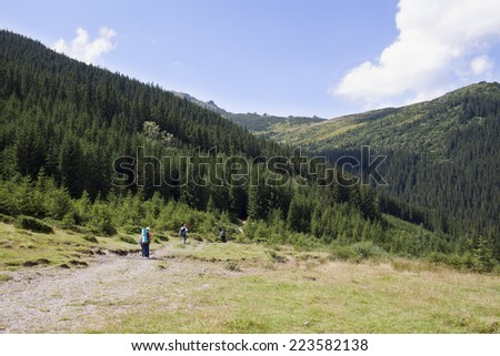 Happy hikers in mountains. Carpathian mountains, Ukraine - stock photo