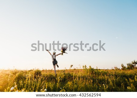 Happy hipster girl enjoy summer on sunset meadow
