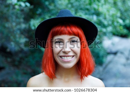 Happy hipster girl in the nature with black hat and without clothes