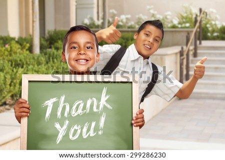 Happy Hispanic Boys Giving Thumbs Up Holding Thank You Chalk Board Outside on School Campus. - stock photo