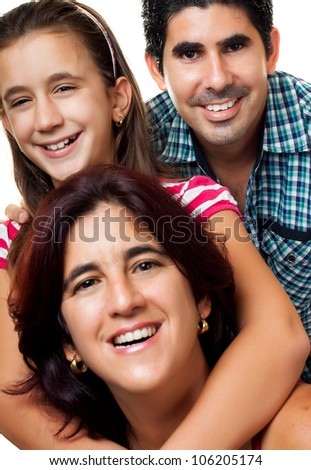 Happy hispanic family consisting of father,mother and daughter having fun together - stock photo