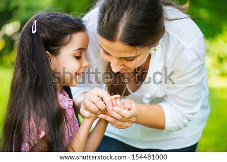 Happy hispanic family playing in fingers games - stock photo