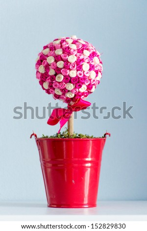 Happy holiday, handmade ribbon tree in red pot - stock photo