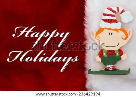 Happy Holidays, A plush red stocking with a Christmas Elf and words Happy Holidays - stock photo