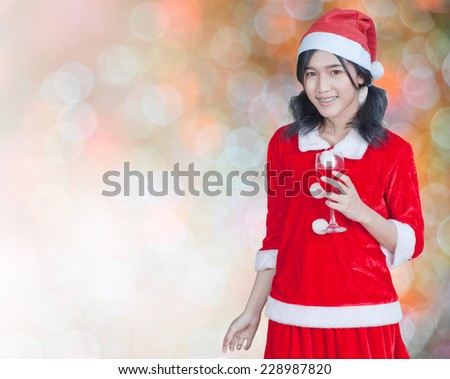 Happy holidays and the new year celebrations. Teenage girl wearing a Santa hat and Santa soak up the atmosphere light and lighting and sound christmas