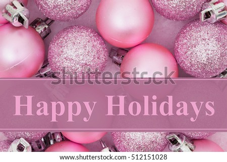 Happy Holidays  greeting, Some pale pink sparkle and matte Christmas ball ornaments with text Happy Holidays