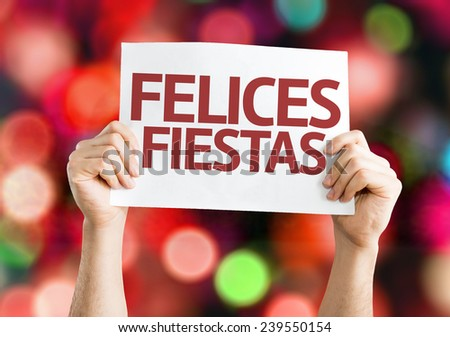 Happy Holidays (in Spanish) card with colorful background with defocused lights - stock photo