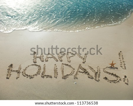 Happy Holidays! Written in sand at the beach. Holiday concept. - stock photo