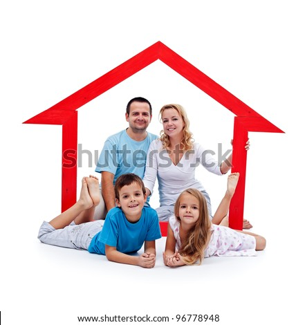 Happy home concept - young family with two kids and house sign - stock photo