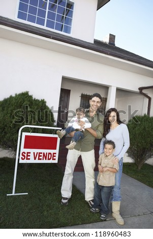 Happy Homeowners with <For Sale> Sign