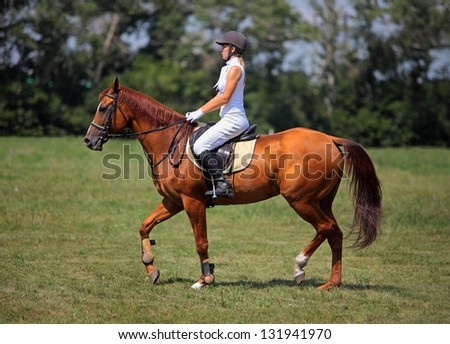 Happy horseback rider - stock photo
